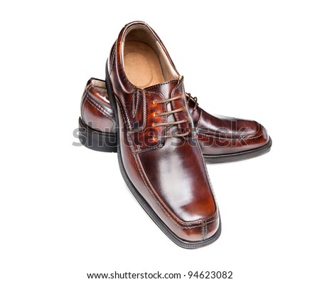 A new pair of brown leather dress shoes on a white background