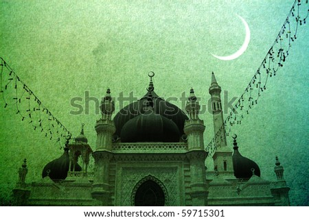 A new Ramadan moon against the silhouette of a Moghul mosque.