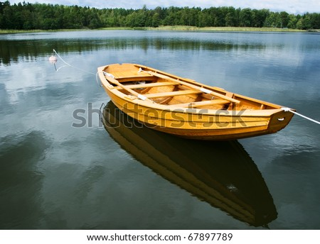 A new rowboat, built by wood. Rowing-boat.