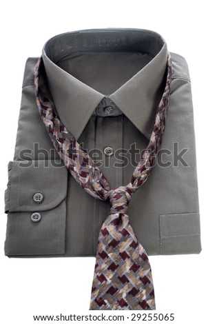 A new shirt and tie isolated against a white background
