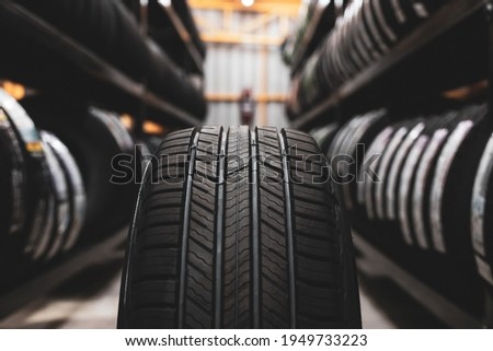 A new tire is placed on the tire storage rack in the car workshop. Be prepared for vehicles that need to change tires.