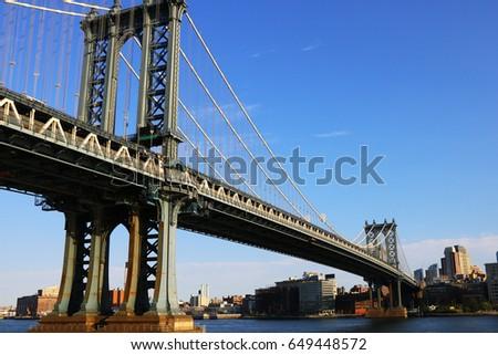 A New York Bridge on blue sky background #649448572