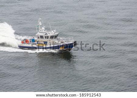 A New York City Police Boat Speeding Across the Harbor