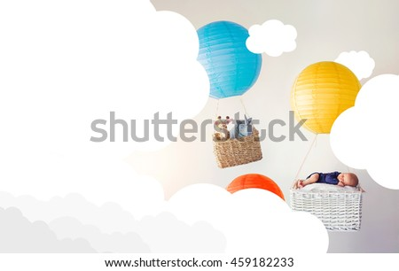 A newborn baby and his stuffed animal friends in two air balloons among the clouds