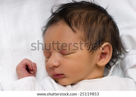 A newborn baby peacefully sleeping