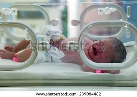 A newborn in nursery after childbirth