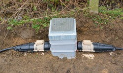 A newly installed electrical underground link box with armoured cable connectors. Hertfordshire. UK