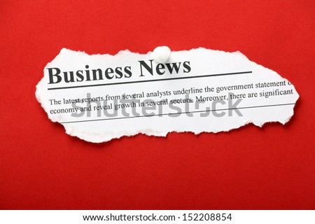 A newspaper clipping with the banner headline Business News