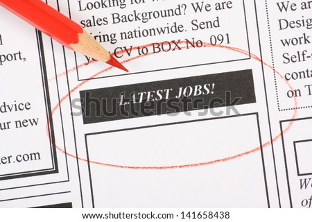 A newspaper column in the classifieds with the Latest Jobs section circled with a red pencil