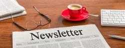 A newspaper on a wooden desk - Newsletter