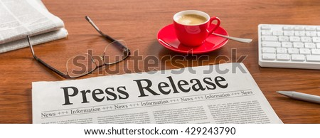 A newspaper on a wooden desk - Press Release