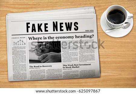 A newspaper showing 'Fake News' as headline.