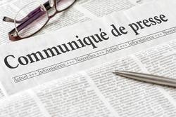 A newspaper with the headline Press Release in french - Communiqué de presse