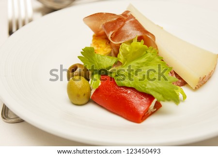 A nice antipasti salad on a white plate