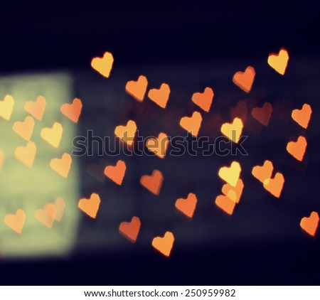 a nice background with defocused lights blurred into the shape of hearts good for holidays like valentine\'s day or wedding announcements or romantic cards