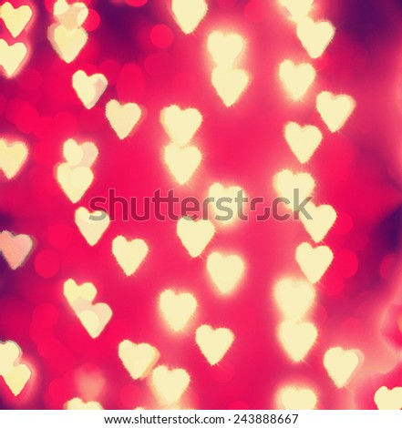 a nice background with unfocussed lights blurred into the shape of hearts - holidays like valentine\'s day or wedding announcements or romantic cards toned with a retro vintage instagram filter effect