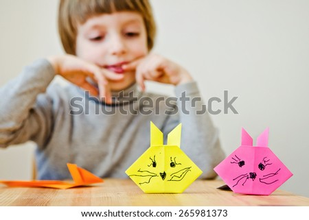 a nice boy with a paper hares