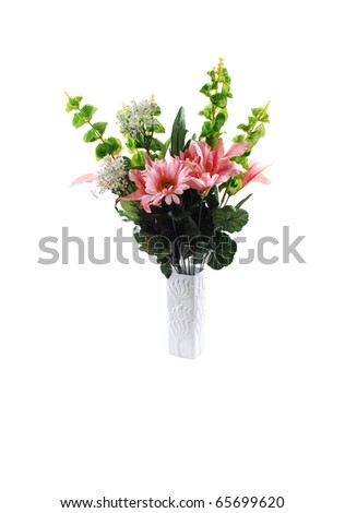 A nice bunch of silk lilies with some green branches in a white vase for white background.