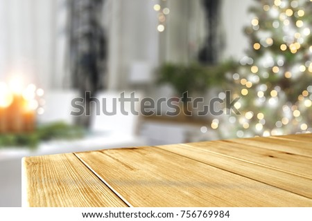 a nice Christmas tree with a green tree and a wooden table ideal for advertising or text