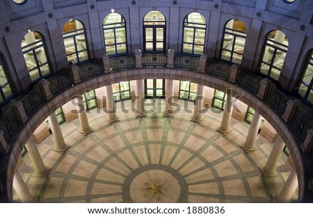 A nice clean shot of the Texas State Capitol Building in downtown Austin, Texas at night.  This is the underground extension as seen from the ground level.