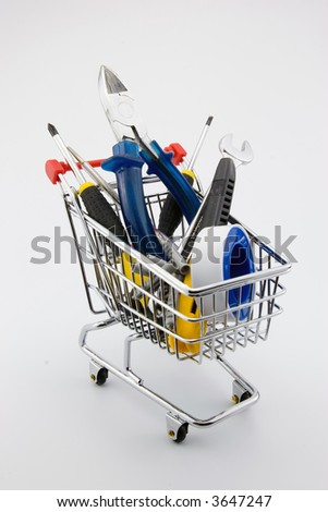A nice figurative picture of a shopping trolley filled with tools. Can be used for webshops etc. - stock photo