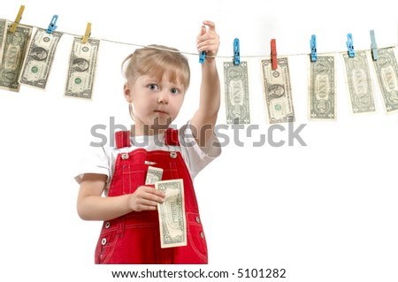 A nice girl hanging up dollars on the clothesline