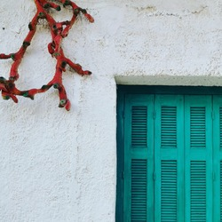 A nice Greek house in Peloponnese, exterior decoration with wood, looking like a coral.