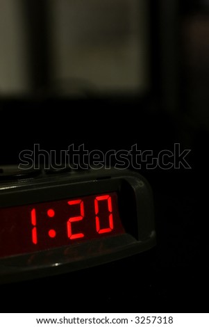 A nice picture of an alarm clock giving the time 1:20. Way past bedtime