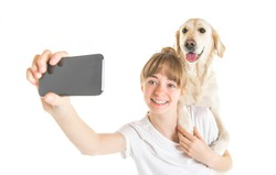 A Nice teen woman and her beautiful Golden Retriever dog over white background