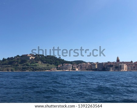 A nice view in the south of france of saint tropez. Taken from a boat we can see the coast the see and the town.