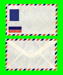 A nice vintage airmail letter envelope, front and back, with a blank stamp, stripes on every side, and lots of copy space. Isolated on a green background.