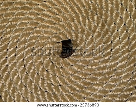a nicely, in the shape of a circle, draped piece of ropes on a sea-ship