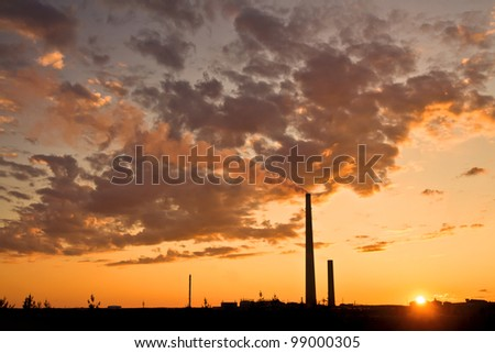 A nickel plant with sunset as background