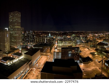 A night image of the Denver downtown core including the Colorado State Capitol.