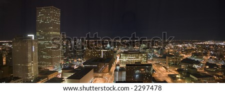 A night panorama of the Denver downtown core including the Colorado State Capitol.