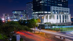 A night shot in the busy street of Sandton Grayston Drive