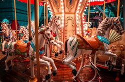 A night shot of a merry Go round, on a rainy night.