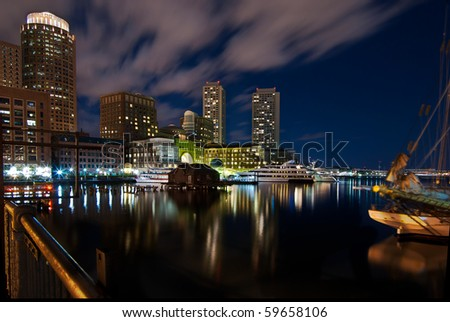A night shot of the Boston inner harbor looking back towards downtown.