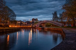 A night shot of the cauldon canal with a bridge crossing at Etruria, Stoke on trent