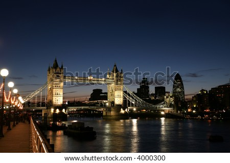a night shot of tower bridge and the city of london