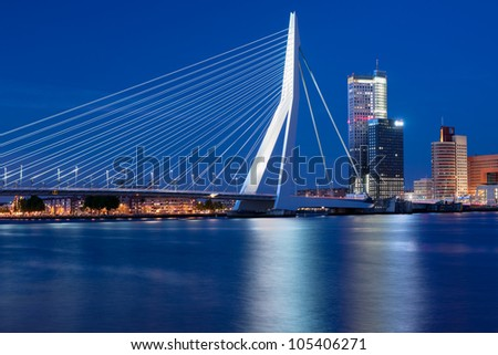 A night view on Erasmus bridge over the Nieuwe Maas river in Rotterdam, Netherlands. GPS information is in the file