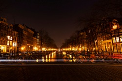 A nightscape from Amsterdam. Bikes, canal and city lights