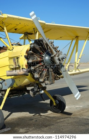 A nine cylinder 600 horsepower radial engine powers this crop duster during its heavy workload