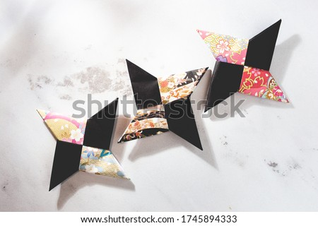 Photo of  A ninja shuriken made from origami. Japanese culture.