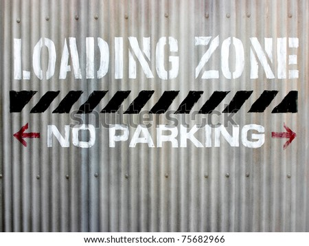 A no parking loading zone sign