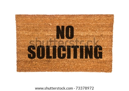 A no soliciting doormat isolated on a white background