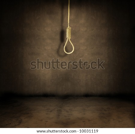 A noose hanging in a dark grungy room - stock photo