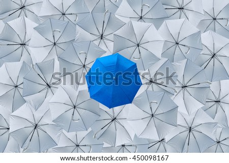 A normal blue umbrella is different from the overturn grey umbrellas, Being different concepts, Business concept, success, Blue umbrella can protect rain, grey umbrellas can't protect rain, Top view.