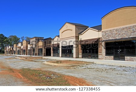 A North American shopping center sits unfinished, a sign of poor economic times.