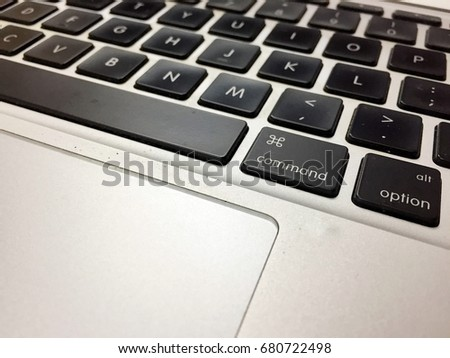 A notebook keyboard emphasise on Command and option buttons #680722498